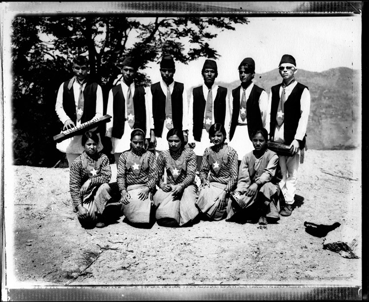 A Maoist 'cultural' team in mountains of Western Nepal, Surkhet district, Dailekh village. The cultural teams' responsibility is to convey the Maoist message through song, dance and theatre. Nepal 2001.