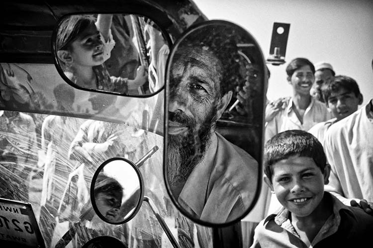 Sher Zaman, 50, squeezed 10 people into his LPG-powered auto-rickshaw, built to carry 3 passengers, to escape the conflict in Swat valley. More than two million people fled in tractors, cattle trucks, auto-rickshaws, and whatever transport means they could find, as mortar shells pummeled their paradise. 2009/05/20