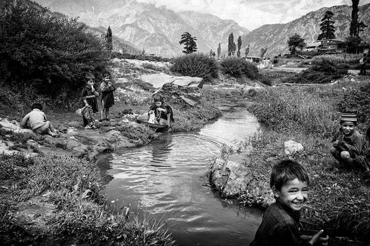 "Children play in a stream in Boyoun village, perched more than a thousand feet above the tourist hub of Kalam town. Away from the main thoroughfare, Boyoun is one of the last vestiges of Swat untouched by conflict and modernity, where children still play traditional games like ""gulidanda"" instead of ""Army versus Taliban"". 2013/08/11."