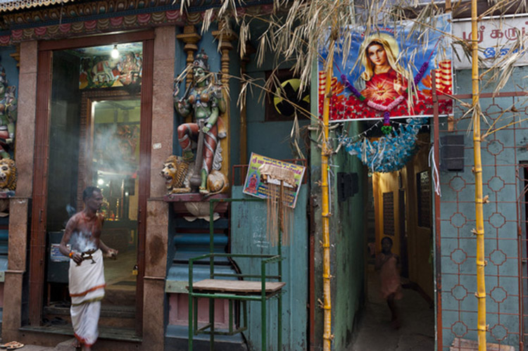 Hindu Temple at the end of Sea Street, near Colombo 13. A child runs out of an alley that leads to very high density housing, where a Catholic banner to Virgin Mary is strung between two bamboo poles.