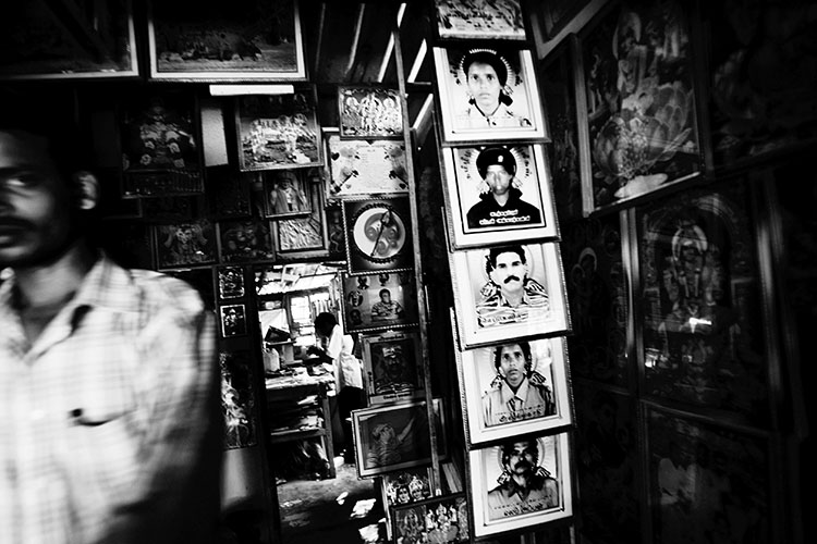 Q. Sakamaki At a religious poster shop in Kilinochchi, the most stronghold of LTTE, the photos of martyrs, or suicide bombers, are also displayed. Sri Lanka, June 2006.