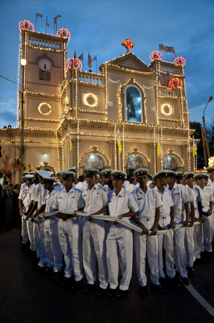 The Navy provide a cordon around the vehicle which will carry the statue of St. Anthony around the neighbourhood. .Kochchikade, Colombo 13. Last day of the annual feast and festival.