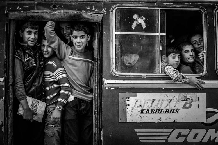 Afghan students in the bus after finishing school in south of Kabul
