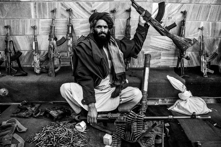 A Taliban showing his weapon to the photographer after surrendering himself to the Government in West Afghanistan