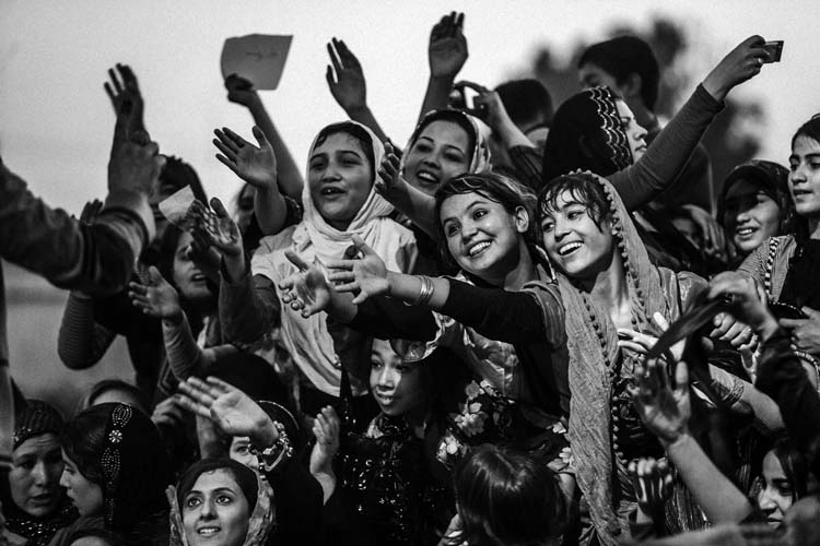 "Fans of Farhad Darya an Afghan singer in a concert in Mazar e sharif. This specific concert is only for females, during Taliban time listening to the music even from CD or cassette was forbidden. the tittle of his concert is ""Peace"""
