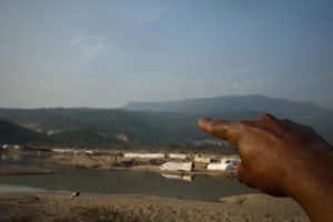 Elaich Mia pointing to Dholai River where the BSF shoot them. This sub-district contributes significant earnings to the Bangladeshi government through the extraction of minerals at the Kalidar Stone Quarry that is beside the river.