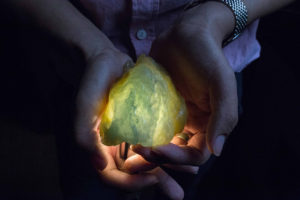 [SeriesTitle: The Price Of Jade] A trader shows a jade stone which he estimates to be worth at least forty or fifty thousands U.S. Dollars in price in the black market, at a hotel room in Yin Jiang, Yunnan Province, China, June 17, 2015. According to several Myanmar jade traders of the black market, almost all the raw jade stones which are being traded in Yin Jiang are smuggled directly from the black market in Myanmar's land of jade in Myanmar's Kachin state where the billion-dollar industry is based.