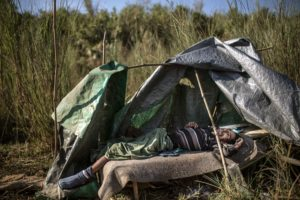 "[SeriesTitle: The Price Of Jade] A heroin-addicted jade miner lies dead inside his makeshift tent which is located close to a ""shooting gallery"" near a jade mine in Hpakant, Kachin State, Myanmar, November 29, 2015. According to local community leaders, the drug-dealers around the jade mines and the villages nearby have been given the opportunity to grow, blind-eyed by local authorities who regularly gets handsome bribes from the drug-dealers."